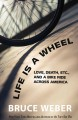 Go to record Life is a wheel : love, death, etc. and a bike ride across...